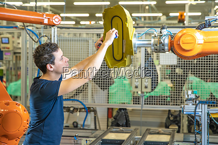 dismantling the robotic arms in the