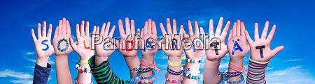 kids hands holding word solidaritaet means