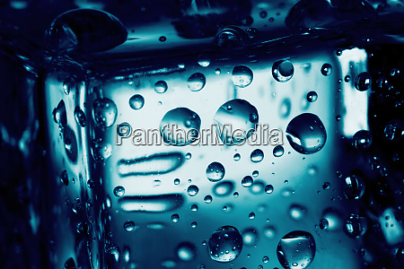 background of ice cube with drops