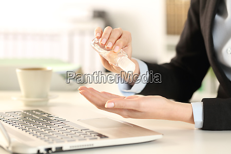 business woman cleaning hands with sanitizer
