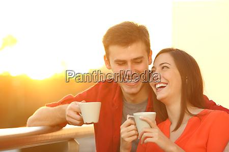 happy, couple, enjoying, coffee, at, sunset - 28277914