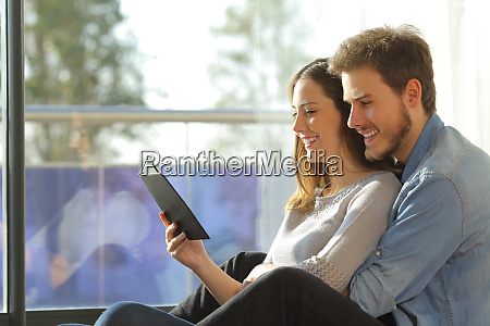 happy, couple, reading, book, on, an - 28277990