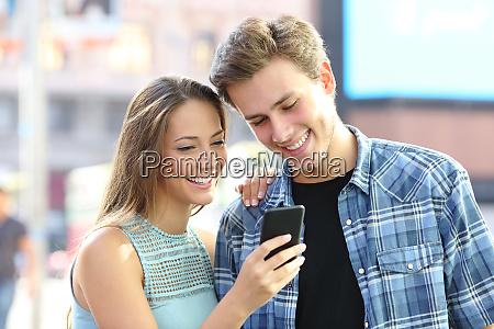 happy, couple, reading, content, on, phone - 28277991