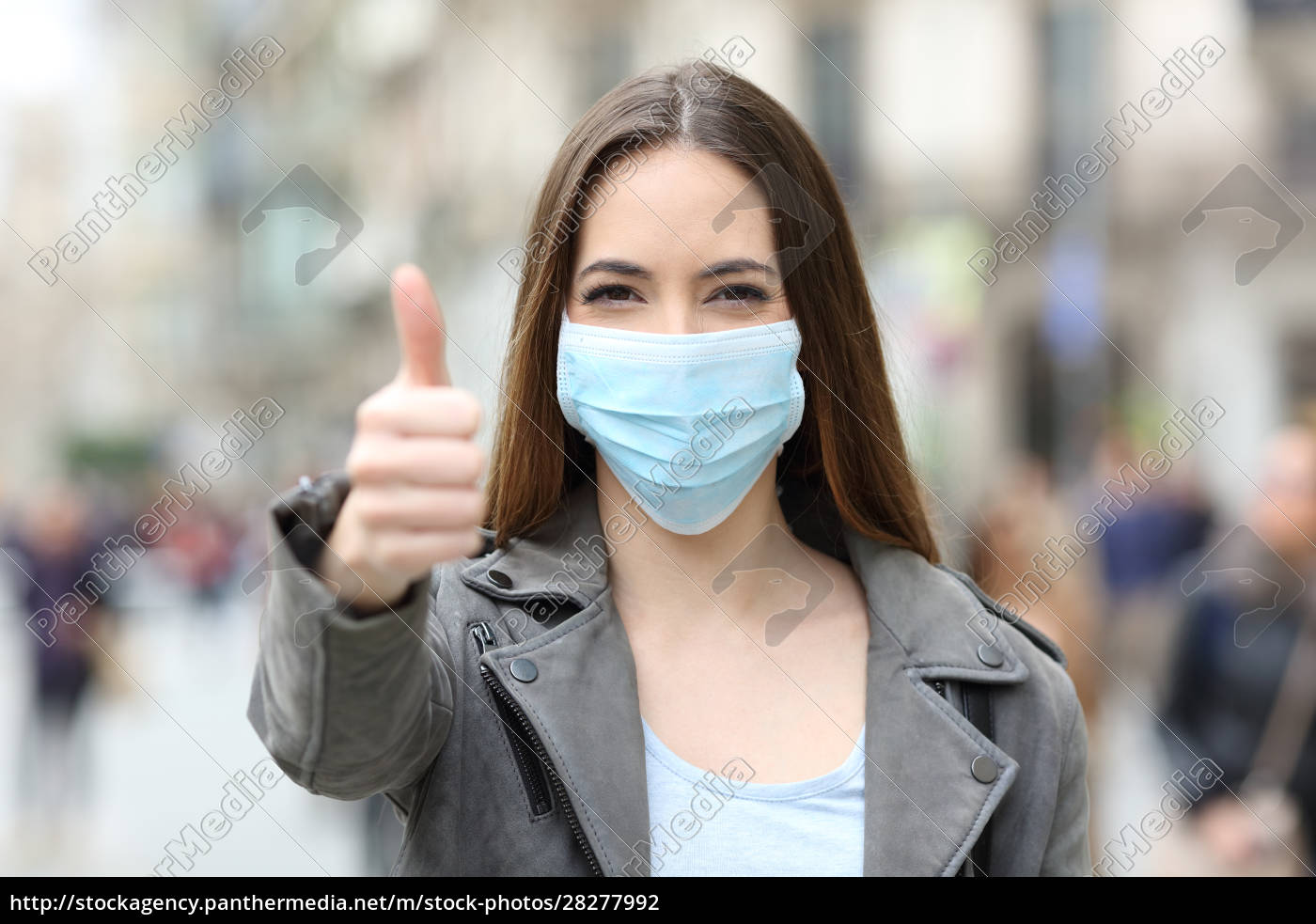 happy, woman, with, mask, gesturing, thumbs - 28277992