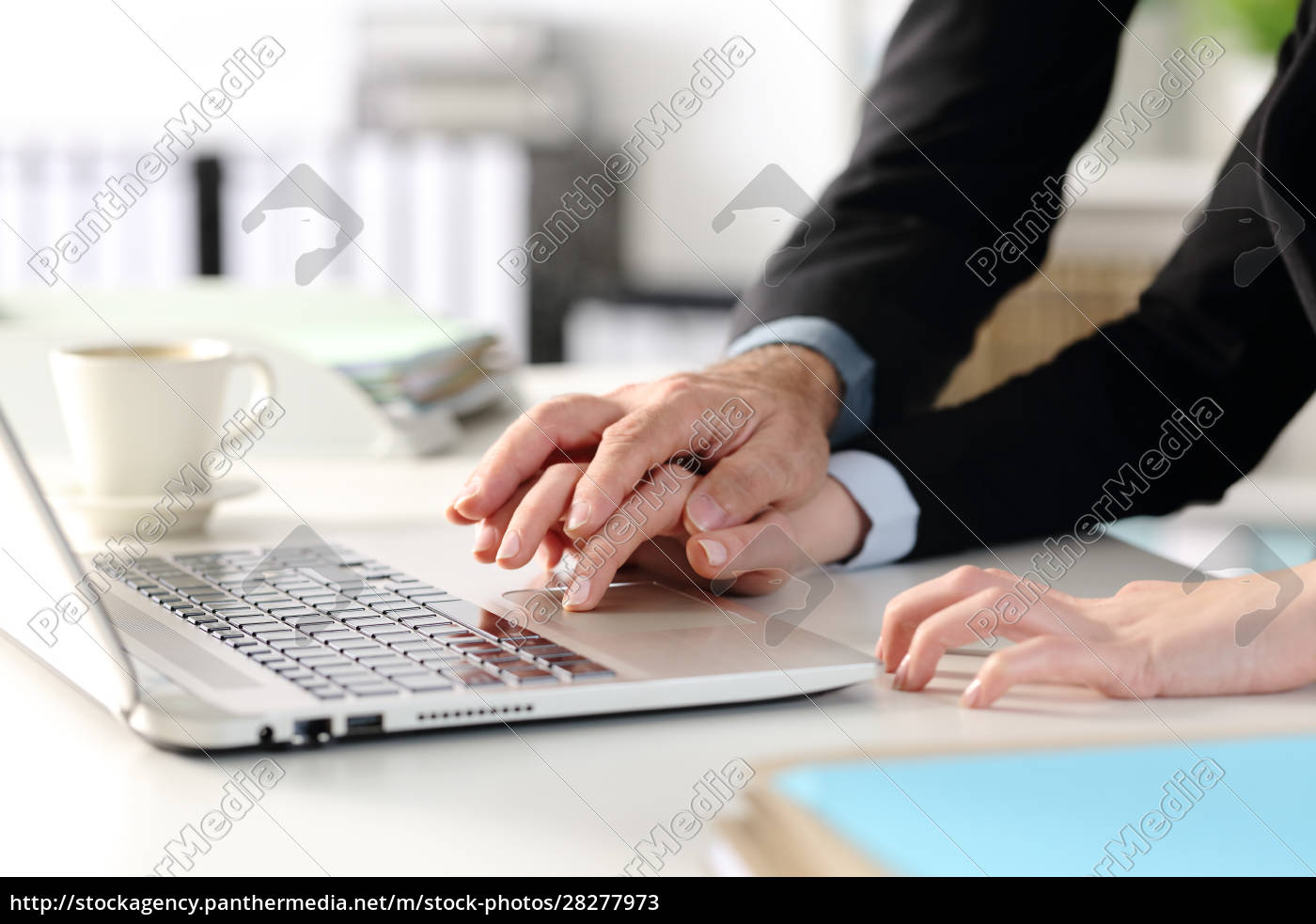 worker, hands, harassed, by, manager, at - 28277973
