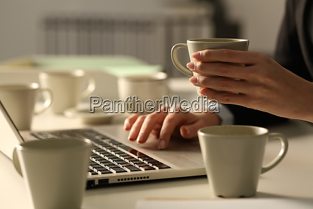 overworked executive hands working late hours