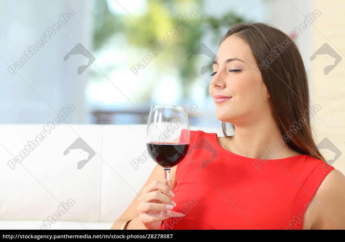 satisfied, woman, smelling, a, red, wine - 28278087