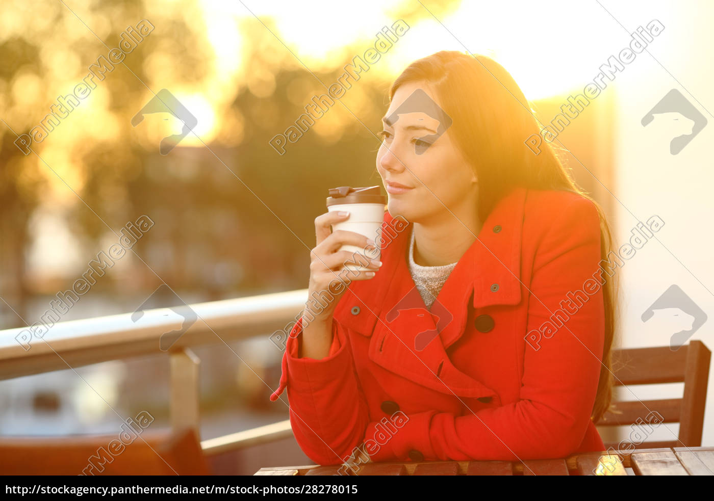 woman, holding, takeaway, coffee, at, sunset - 28278015