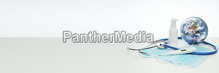 world globe stethoscope medical masks sanitizer