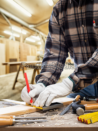 carpenter, at, work, on, wooden, boards. - 28279343