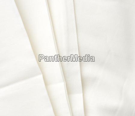 white cotton fabric folded full frame