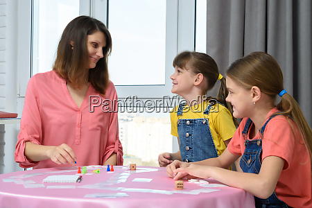 children happily looked at mom playing