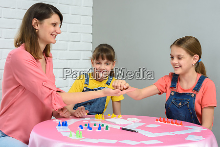 mom gives cubes to daughter playing