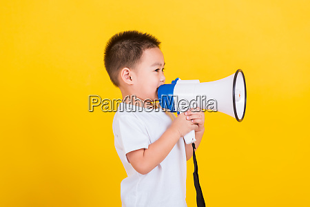 child boy holding and shouting or