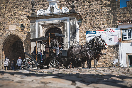 horse drawn carriage carrying tourists in