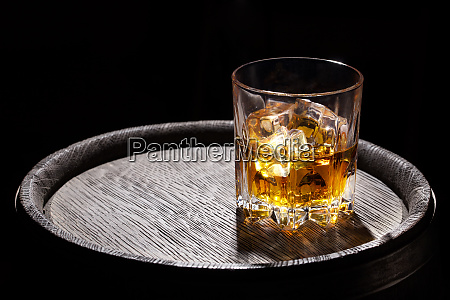 glass of whiskey with ice on