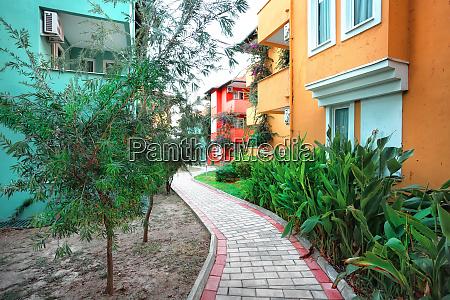laid stone walkway between colorful houses