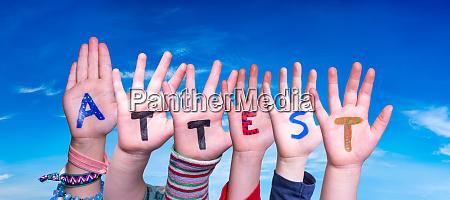 children hands building word attest means