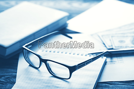 business concept with glasses hundred dollar