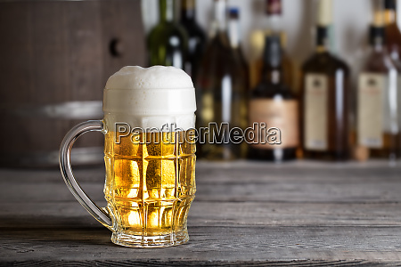 large glass of light beer with