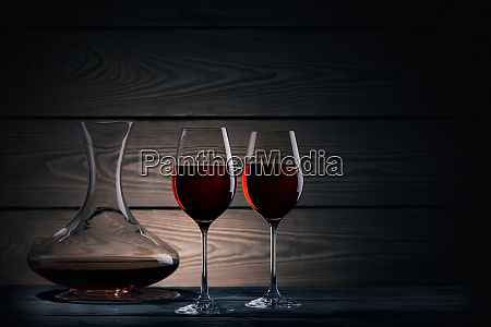 two glasses and decanter of red