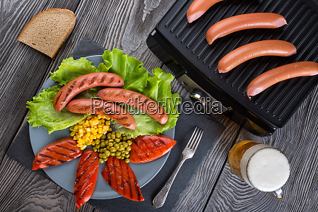 fried sausages on a plate with