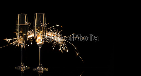 two tall glasses of champagne in