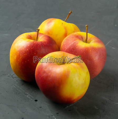 apples on black stone table background