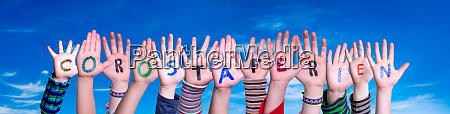 children hands building word corostaferien means