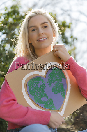 woman holding climate change protest sign