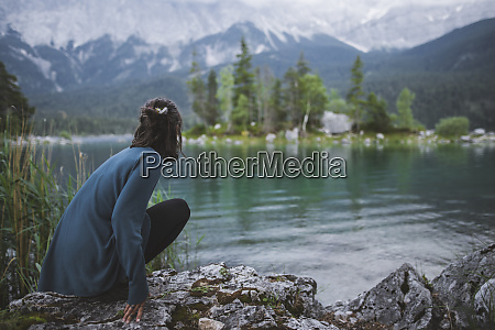 germany bavaria eibsee young woman crouching
