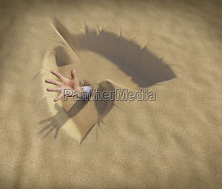 hand reaching from lungs shaped sand