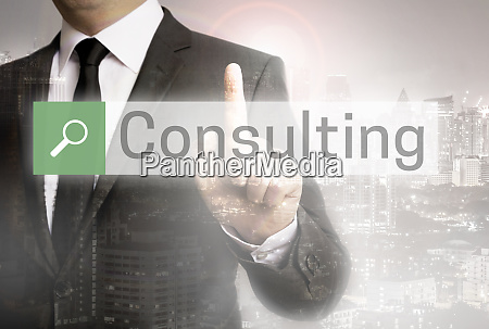 consulting browser with businessman and city