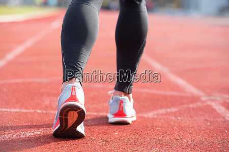 athletic person on running track getting