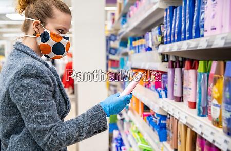 woman buying cosmetics in a shopping