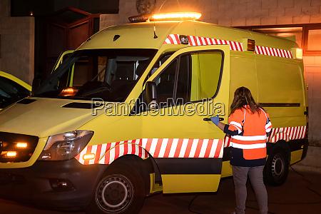 night scene of an unrecognizable paramedic