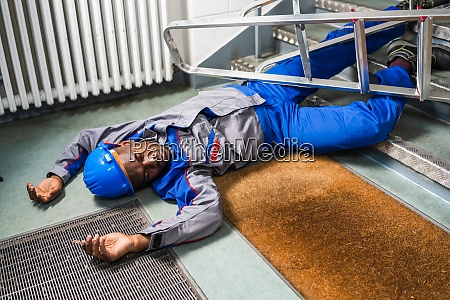 handyman fallen from ladder lying on