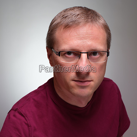 man with glasses and skeptical glimpse