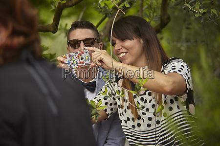 girl takes a selfie among people