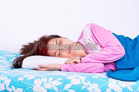 beautiful young girl in pajamas calmly