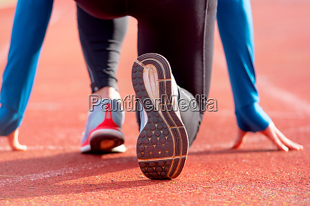 back view of an athlete getting
