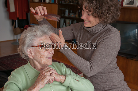 senior woman gets her hair styled