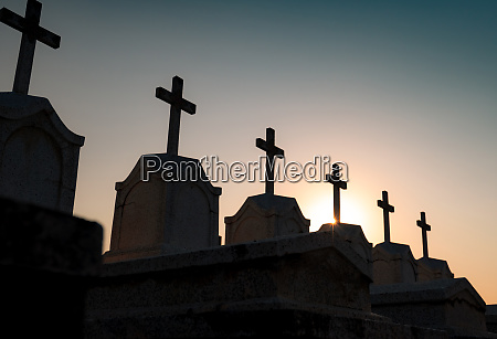 cemetery or graveyard in the night