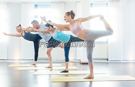 four young and fit yoga students