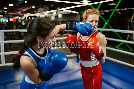 women in gloves boxing on the