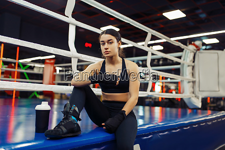 woman in black boxing bandages sitting
