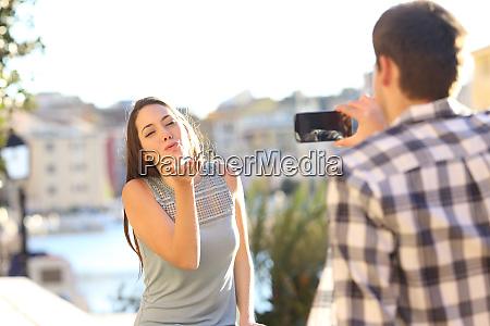 tourists couple taking photos on phone