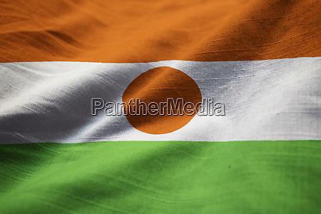 closeup of ruffled niger flag niger