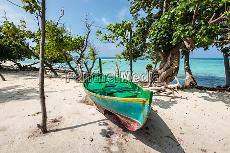 colorful wooden boat on the coast