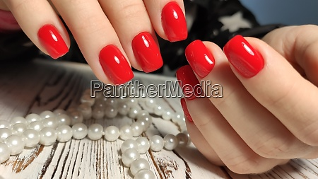 manicured nails colored with red nail